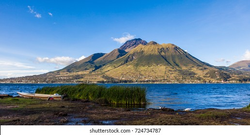 Panorama of Imbabura volcano, with blue sky and  San Pablo Lake