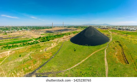 Panorama of the industrial part of the city of Shymkent. Black Mountain waste on the outskirts of the city. Lead slag next to the residents' houses. Poisoning the river and land factory waste
