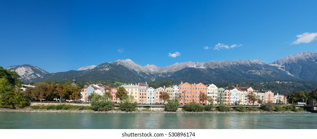 Panorama of Innsbruck with colored houses, Inn river and blue sky , Tyrol, Austria