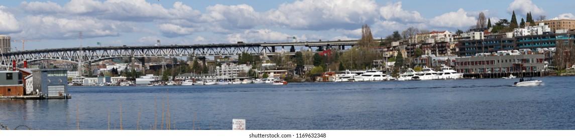 Panorama of Interstate I5 freeway bridge from industrial marina on Lake Union in Seattle, Washington