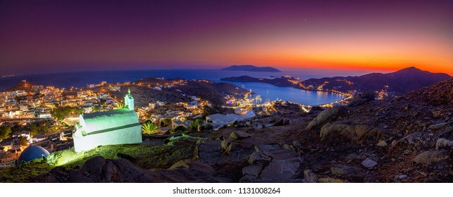 Panorama of Ios Chora and old harbor at sumset, Cyclades, Greece.