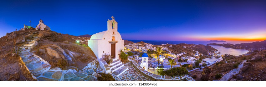 Panorama of Ios Chora and old harbor at sunset, Cyclades, Greece.