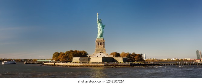 Panorama of island of Liberty with statue of Liberty seen from the ferry in the Hudson river. Symbol of the New york.