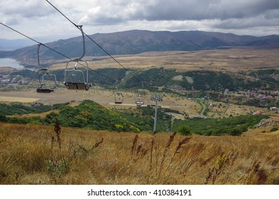 Panorama of Jermuk spa resort city and Arpa river canyon form ropeway station. Armenia.