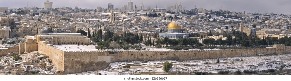 Panorama of the Jerusalem Old City under snow, view from the Mountain of Olives