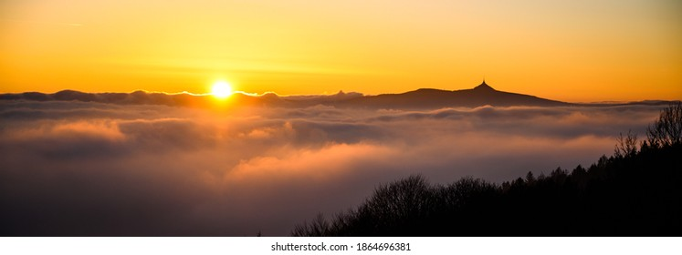 Panorama of Jested mountain ridge with silhouette of unique mountain hotel and TV transmitter. Evening weather inversion. Liberec, Czech Republic - Shutterstock ID 1864696381