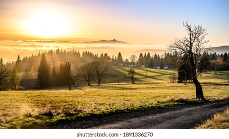 Panorama of Jested mountain ridge with silhouette of unique mountain hotel and TV transmitter. Evening weather inversion. Liberec, Czech Republic - Shutterstock ID 1891336270