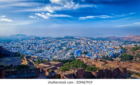 "Panorama of Jodhpur, also known as ""Blue City"" due to the vivid blue-painted Brahmin houses. View from Mehrangarh Fort (part of fortifications is also visible).  Jodphur, Rajasthan, India"