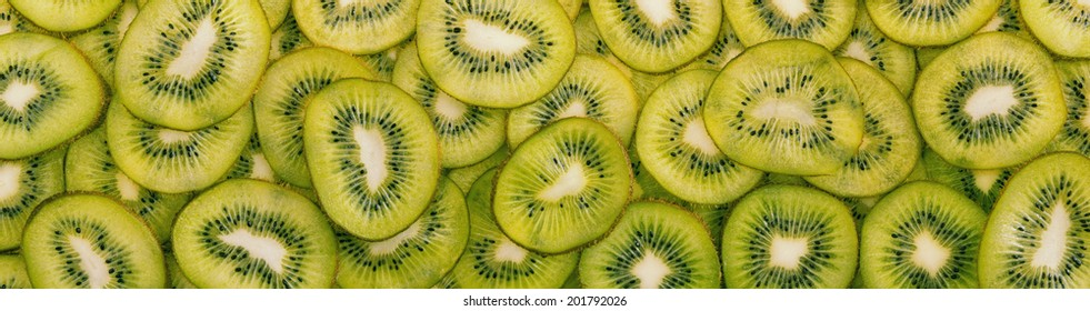 Panorama of juicy sliced kiwi