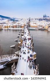 Panorama. Karlov or Charles bridge in Prague in winter