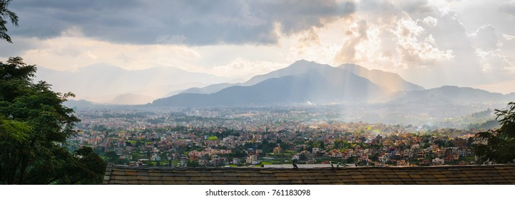 Panorama of Kathmandu valley, with cloudy sky and sunset, town and hills, from Shivapuri Nagsrjun National Park in Nepal.