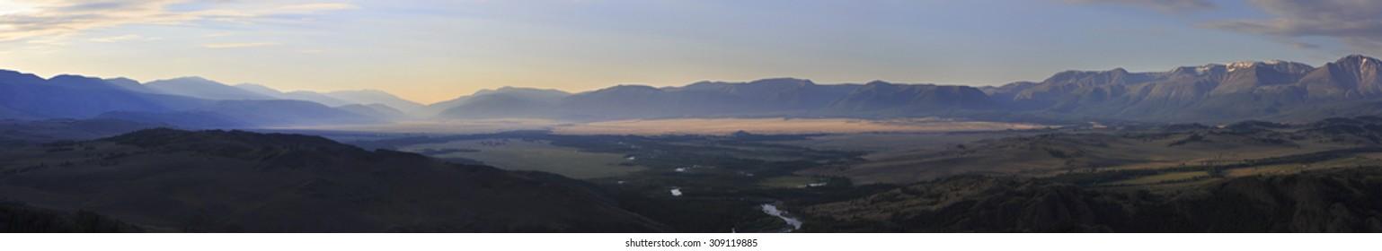 Panorama of Kuray mountain range and North Chuya ridge at the dawn.