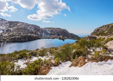 Panorama of Lagoa Comprida, a Lake in the Serra da Estrela National Park, on a Snowy Winter Day in Portugal