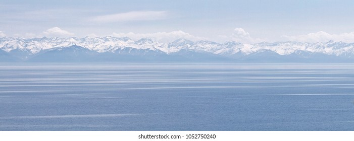 Panorama of Lake Baikal, Siberia, Russia. View on Hamar Daban mountains.