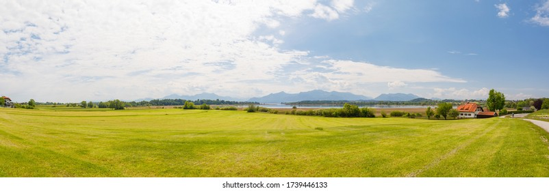 Panorama of lake Chiemsee with alps in background