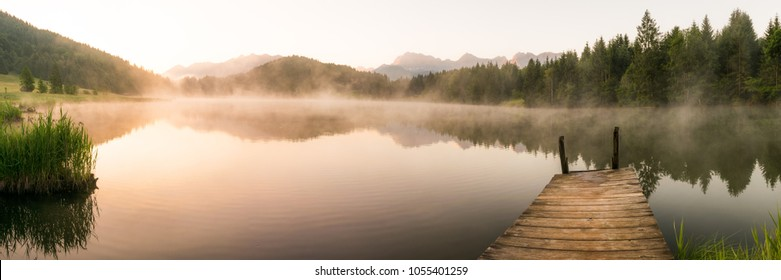 Panorama of lake Geroldsee in the Alps of Bavaria on a summer morning