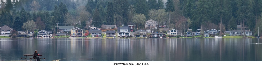 Panorama at the lake with houses and person enjoying view In Spanaway Washington near Tacoma and Seattle in the Puget Sound region of the Pacific Northwest