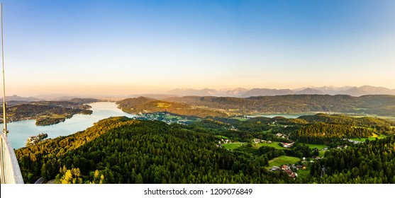 Panorama of Lake and mountains at Worthersee Karnten Austria. View from Pyramidenkogel tower on lake and Klagenfurt the area.