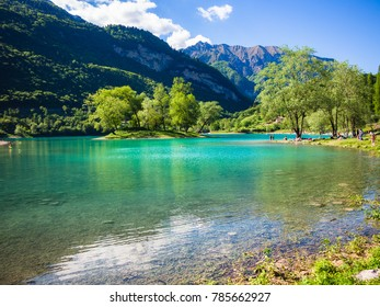 Panorama of Lake Tenno surrounded by Italian mountains.