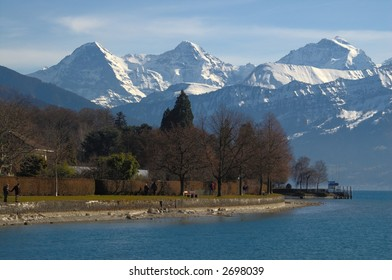 Panorama: Lake Thun with alpine mountains Eiger, Moench, Jungfrau