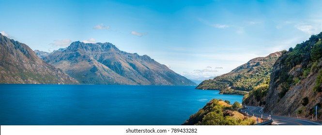 Panorama of of Lake Wakatipu with the winding road along the lake shore, not far from Queenstown, in the Southern Island of New Zealand.