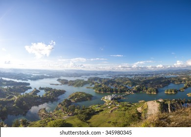 Panorama of the lakes and islands in Guatape taken from Piedra el Penol with blue sky, near Medellin, Colombia.