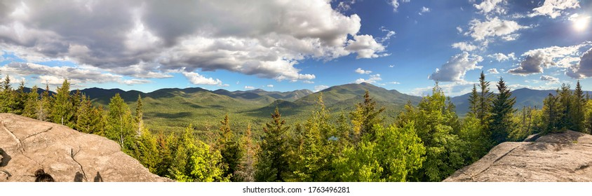 Panorama of landscape of Adirondacks mountains in upstate New York near Lake Placid.  Beautiful sunny summer day over the forest.