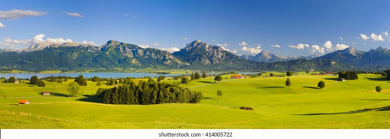 panorama landscape in Bavaria with lake Forggensee and alps mountains nearby city Fuessen