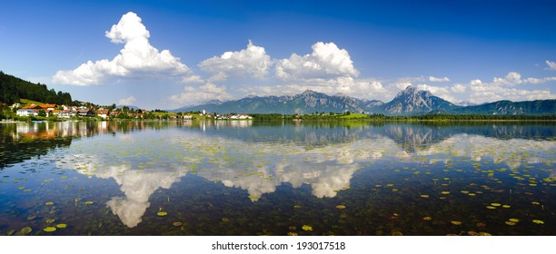 panorama landscape in Bavaria at lake Hopfensee with alps mountains