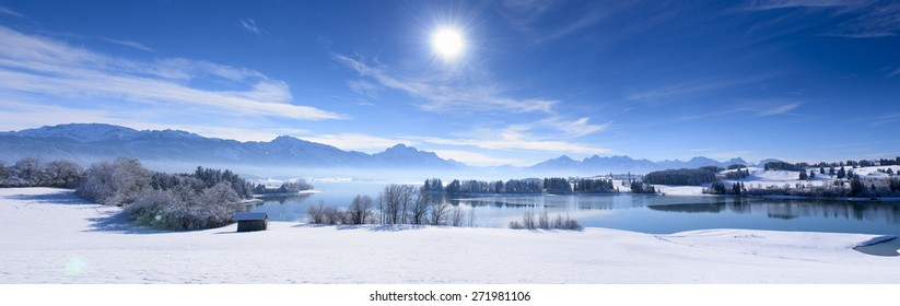 panorama landscape in Bavaria nearby alps mountains in winter