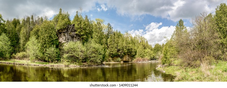 Panorama landscape of the bend in a northern woodland river in Springtime