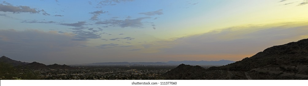 Panorama landscape of the city of Phoenix at sunset. The valley of the sun. Top view. USA, Arizona.