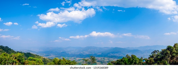 Panorama landscape high view of mountain view with blue sky and white cloud at Chiangrai, Thailand