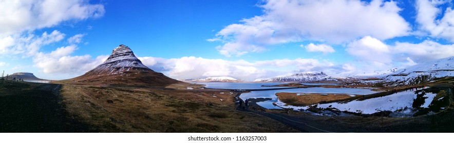 Panorama landscape of Kirkjufell mountain at Iceland in early of summer with blue sky and wonderful cloud