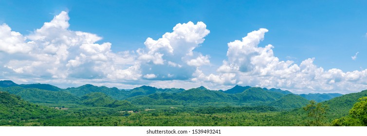 Panorama landscape nature background. mountains forest greenery and blue sky.