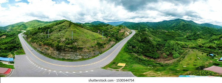 Panorama landscape nature background. road mountains forest greenery and blue sky.