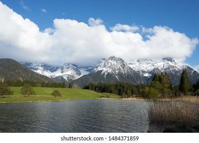 Panorama landscape of Schmalensee Lake and Karwendel Mountains, German alps in May in spring. Located near Mittenwald, Garmisch-Partenkirchen, Bayern / Bavaria region of Germany.