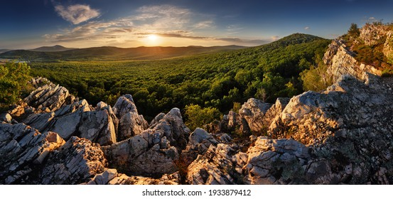 Panorama landscape at sunset with forest and rocks from Studeny castle near Gymes, Slovakia
