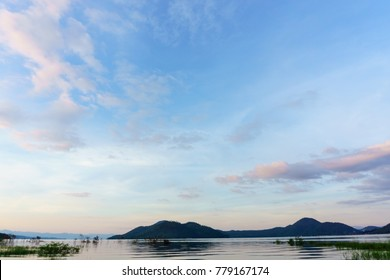 panorama landscape view of amazing beautiful island and water with blue sky and cloud when twilight in srinakarin dam,kanjanaburi,thailand. great scene of nature in the evening.