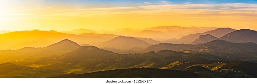 Panorama landscape view during sunset in spring from Graz Schockl mountain in Styria, Austria. Famous tourist destination ,hiking and mountain biking spot.