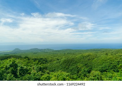 panorama landscape view of green jungle against the sky and cloud at izu oshima island or godzilla island. japan when summer.