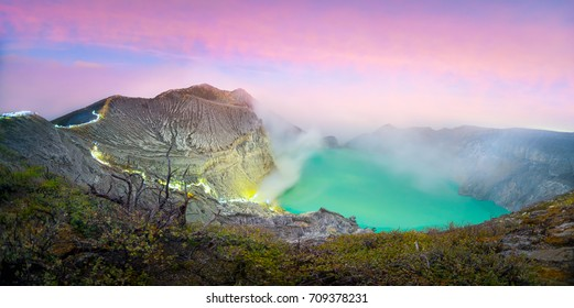 Panorama landscape view of Kawah Ijen at Sunrise. The most famous tourist attraction in Indonesia.