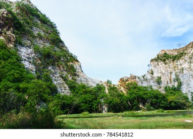 panorama landscape view of mountain  with small river pass through the jungle against blue sky and cloud.