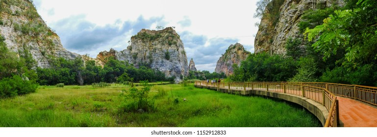 panorama landscape view of the rocky mountains. trees and swamps. there are beautiful sky and clouds. nature conservation and ecotourism.