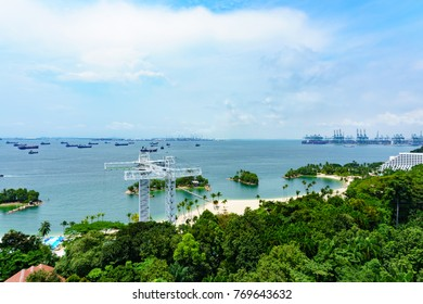 panorama landscape view of singapore sea and siloso beach with blue sky and cloud, POV from cable car.