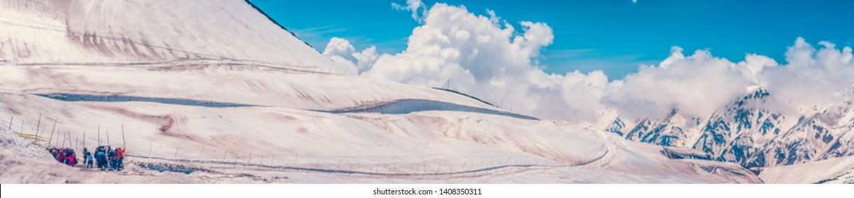 Panorama lanscape snow mountains at Tateyama Kurobe alpine with blue sky background, Toyama Prefecture, Japan