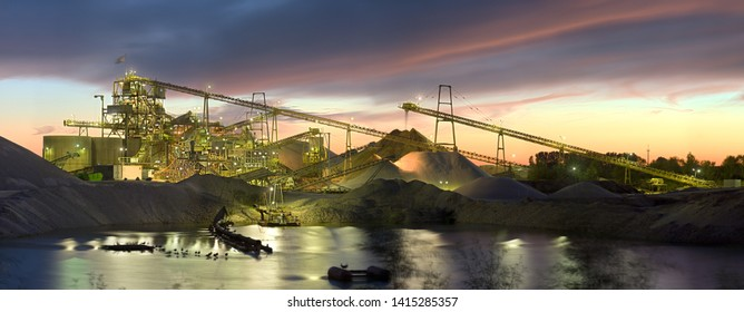 Panorama of a large illuminated gravel plant with colorful evening sky.