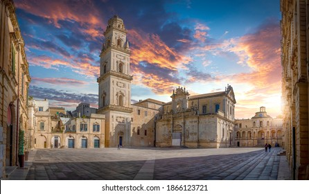 Panorama of Lecce, Puglia, Italy at sunset. Piazza del Duomo square, Campanile tower and Virgin Mary Cathedral (Basilica di Santa Maria Assunta in Cielo), Caritas Diocesana. Baroque city of Apulia