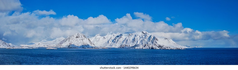 Panorama of Lofoten islands and Norwegian sea in winter with snow covered mountains. Lofoten islands, Norway