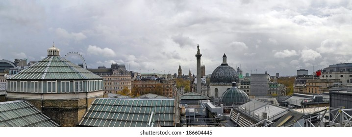 Panorama of London including the roofs and temperature control systems of the National Gallery in the foreground. In the back ground are Nelson's Column, Trafalgar Square and Parliament.